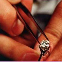 jeweller checking solitaire diamond stone