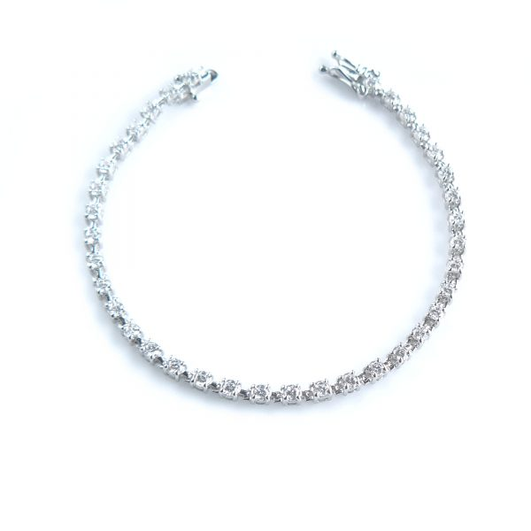 Tennis bracelet with diamond simulants of 1 carat size in silver with white gold plating or solid white gold