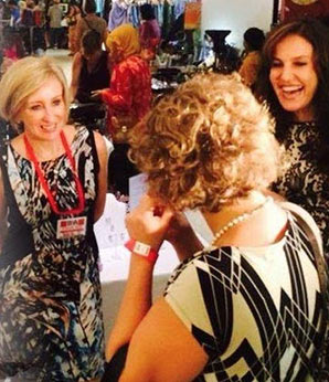 distributor party showing 3 woman having fun selling and buying jewelry