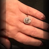 testimonial photo of a delicate engagement halo ring from a very happy customer