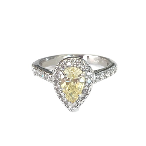 Ring 1.38ct (8x5mm) Diamonds Simulant Pear shape (teardrop)-YELLOW COLOR, prong set, surrounded by small brilliant simulants 1.5mm, and 1.75 mm on a half band prong set.Silver 925 with white gold plating.