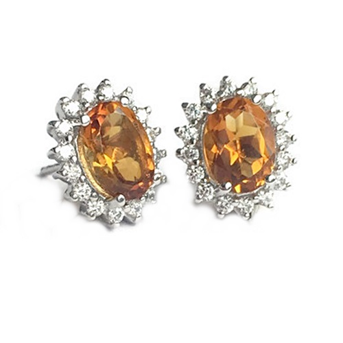 Earrings Citrine Oval Cut with diamond simulants in halo design. Sterling Silver with white gold plating.