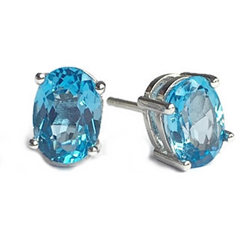 Earrings Blue Topaz Oval Cut Stud. Sterling silver with white gold plating.