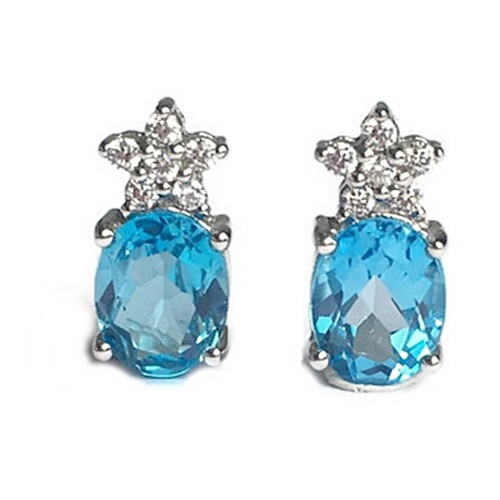 Earrings Blue Topaz Oval Cut with 5 small stones in flower shape. Sterling silver with white gold plating.