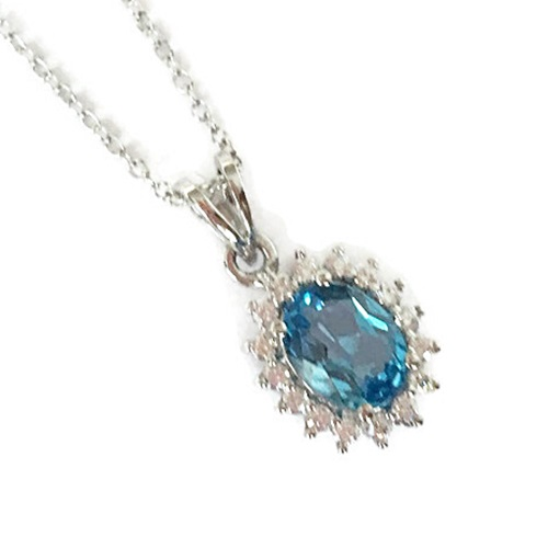 Pendant Blue Topaz Oval Cut with halo design sterling silver with white gold plating.
