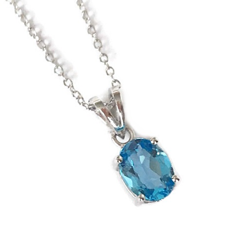 Pendant Blue Topaz Oval Cut in Sterling Silver with White Gold Plating.