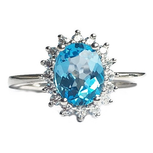 Ring Blue Topaz Oval Cut with diamond simulants surrounded by Diamond Simulants.. Sterling Silver with white gold plating.