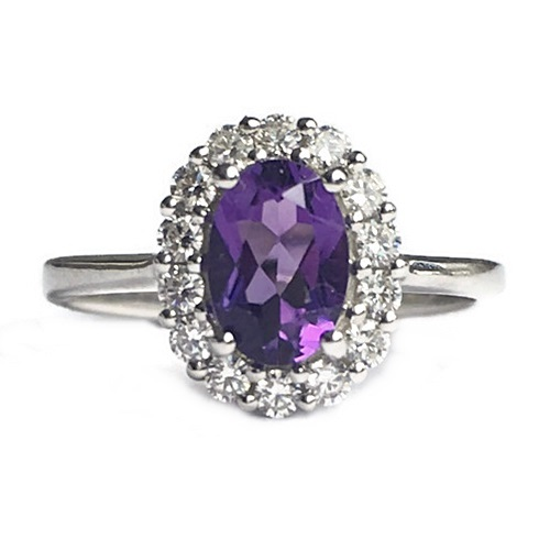 Ring Amethyst Oval Cut with diamond simulants in halo design. Sterling Silver with white gold plating.