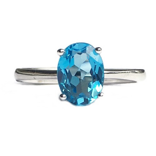 Ring Blue Topaz Oval Cut Semi Precious Stone. Sterling Silver with white gold plating.