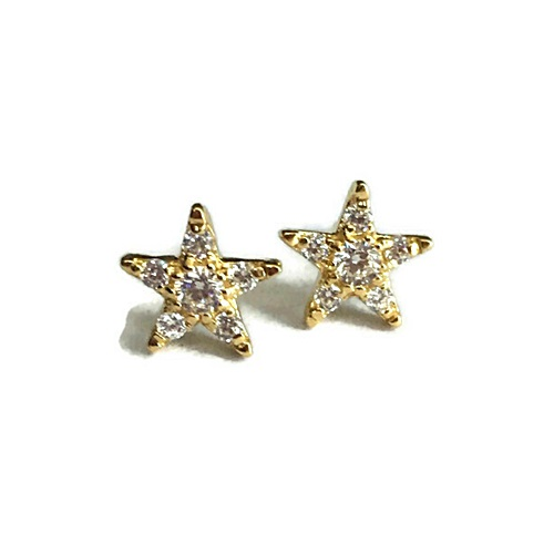 earring star shape with sparkling diamonds. sterling silver with yellow gold plating