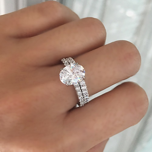Oval and pave ring with eternity band
