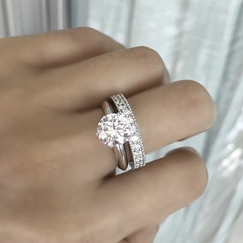 Solitaire Ring with Milgrain Eternity Band.