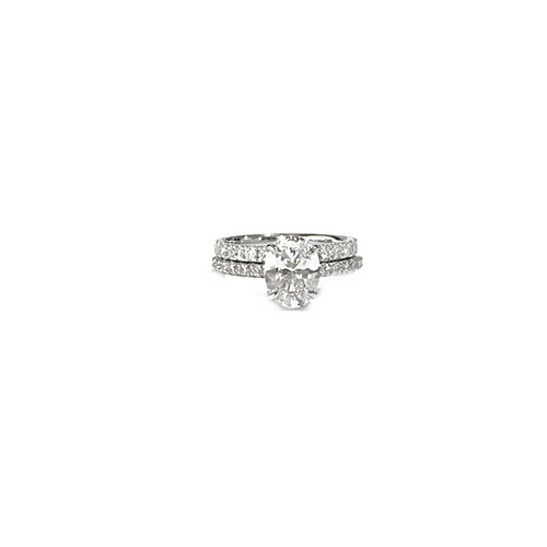 Oval cut engagement ring with full eternity diamond ring